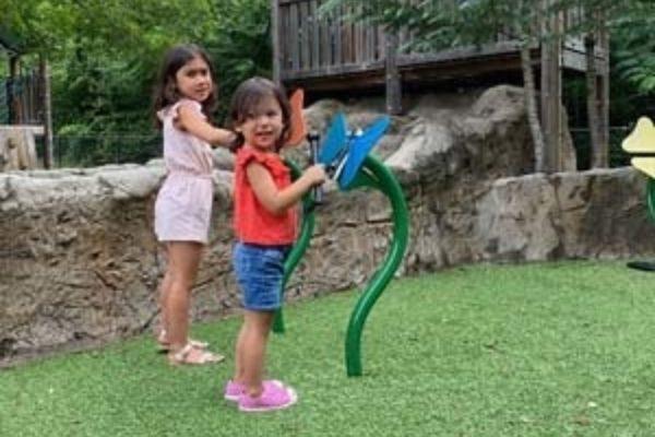 Two girls playing butterflies