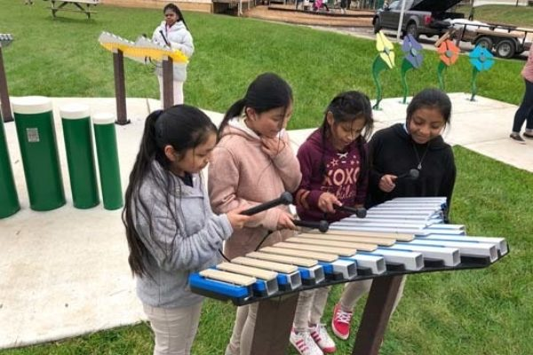 Group of students playing the Duet