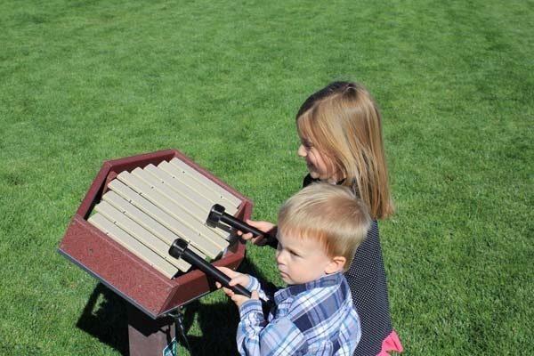 Boy and girl playing the Rhythm