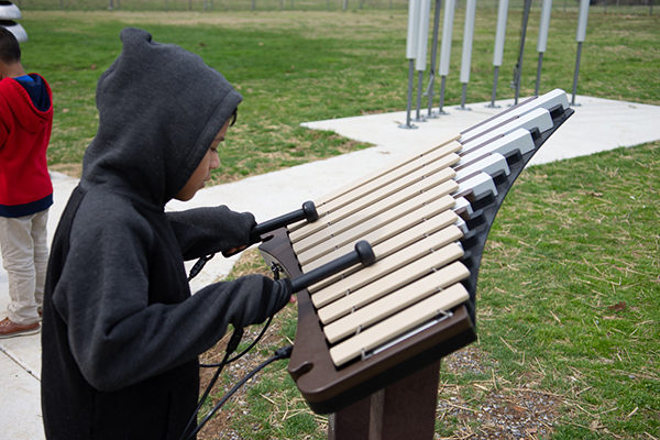 Boy playing piper instrument