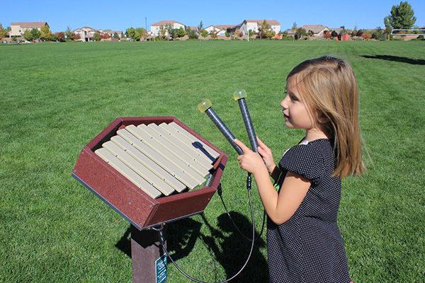 Girl playing the Rhythm