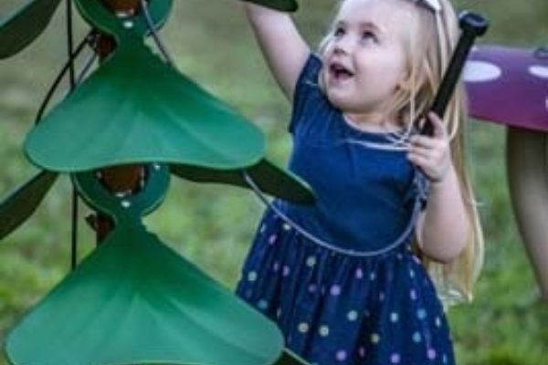 Young girl playing the Tenor Tree