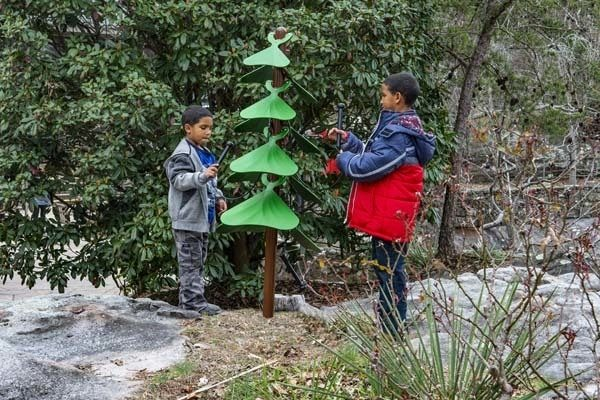 Two boys playing the Tenor Tree